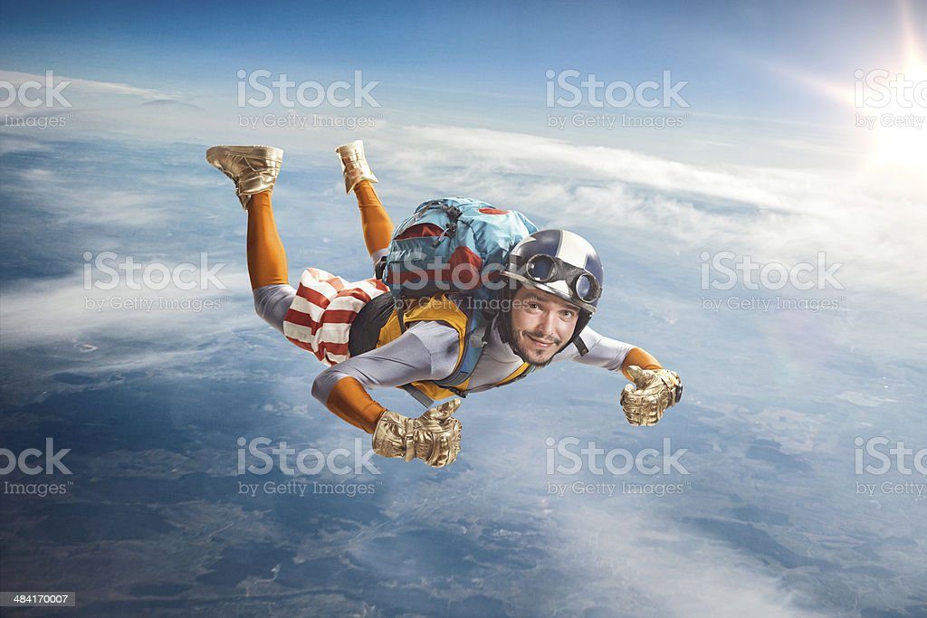 Circus skydiver falls through the air. stock photo