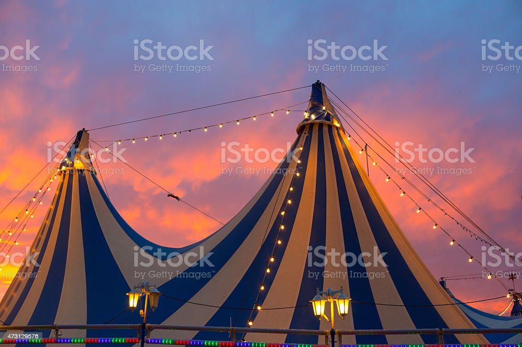Circus tent in a dramatic sunset sky colorful stock photo