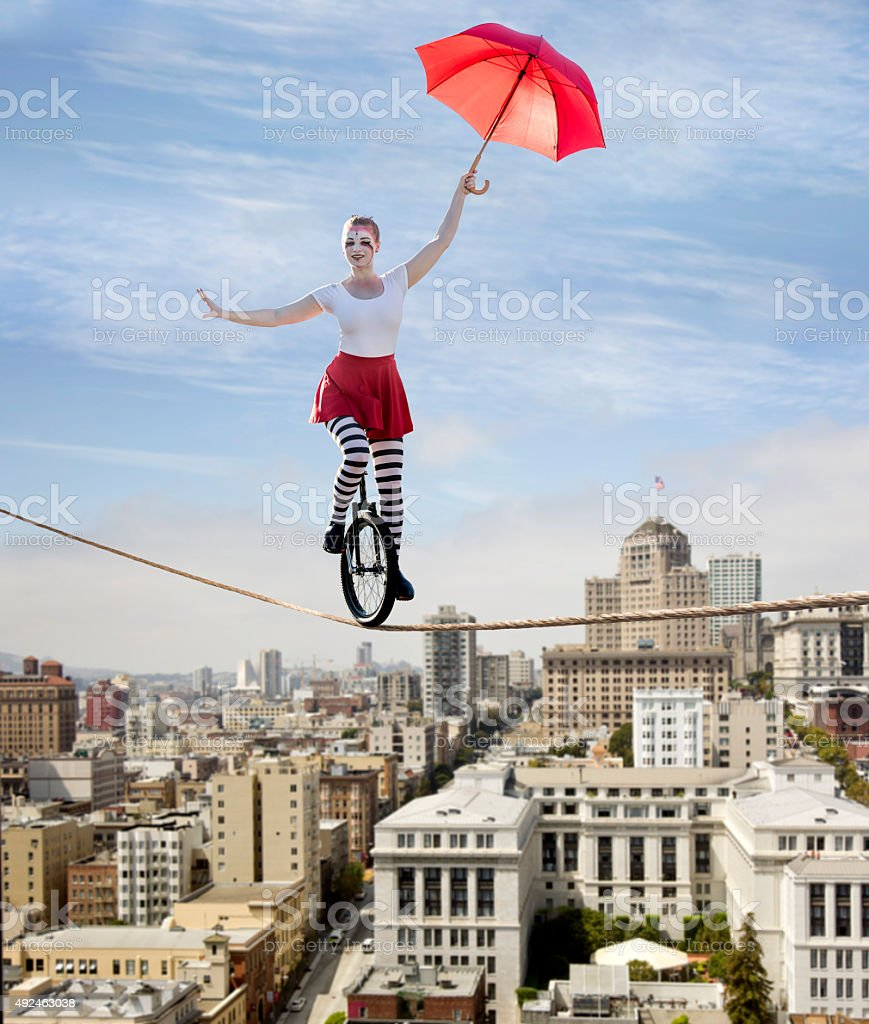 Circus Tightrope Walker on a Unicycle stock photo