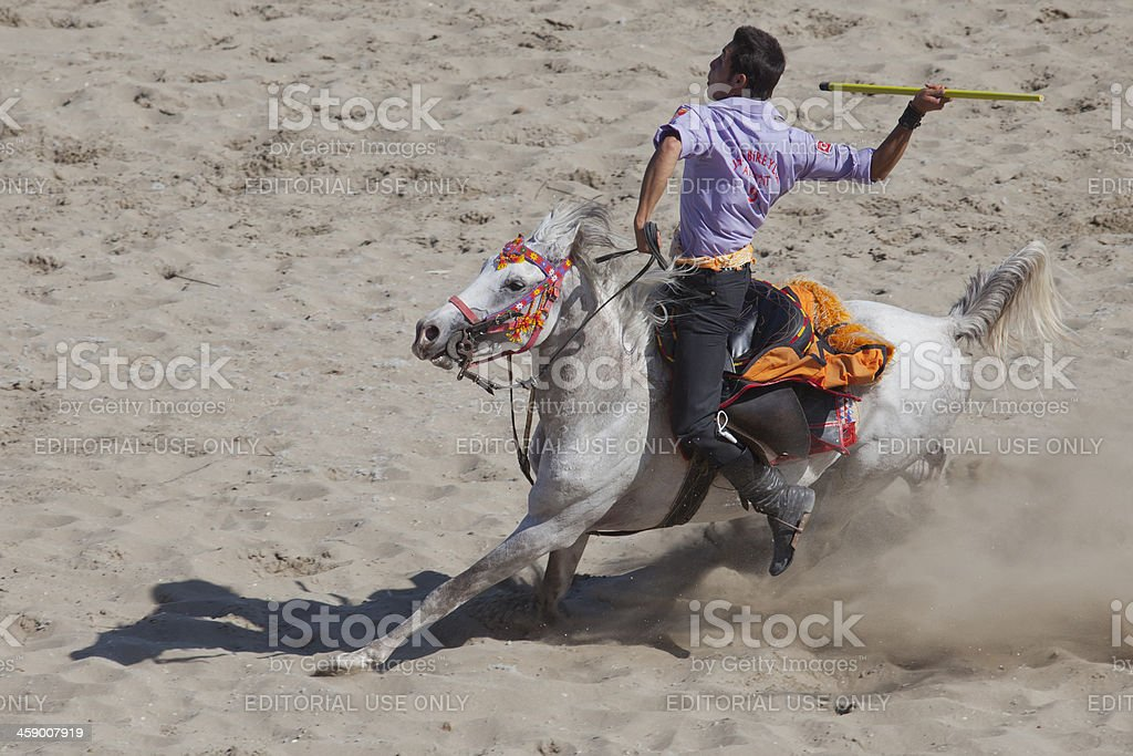 Cirit player's man riding white horse royalty-free stock photo