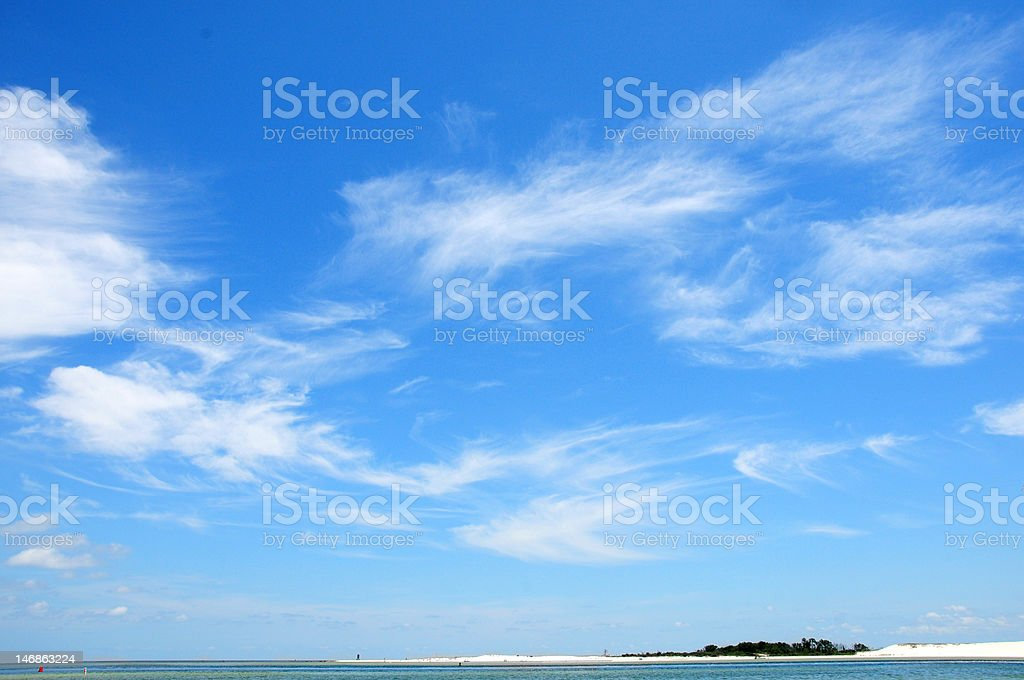 Cirrus clouds over ocean stock photo