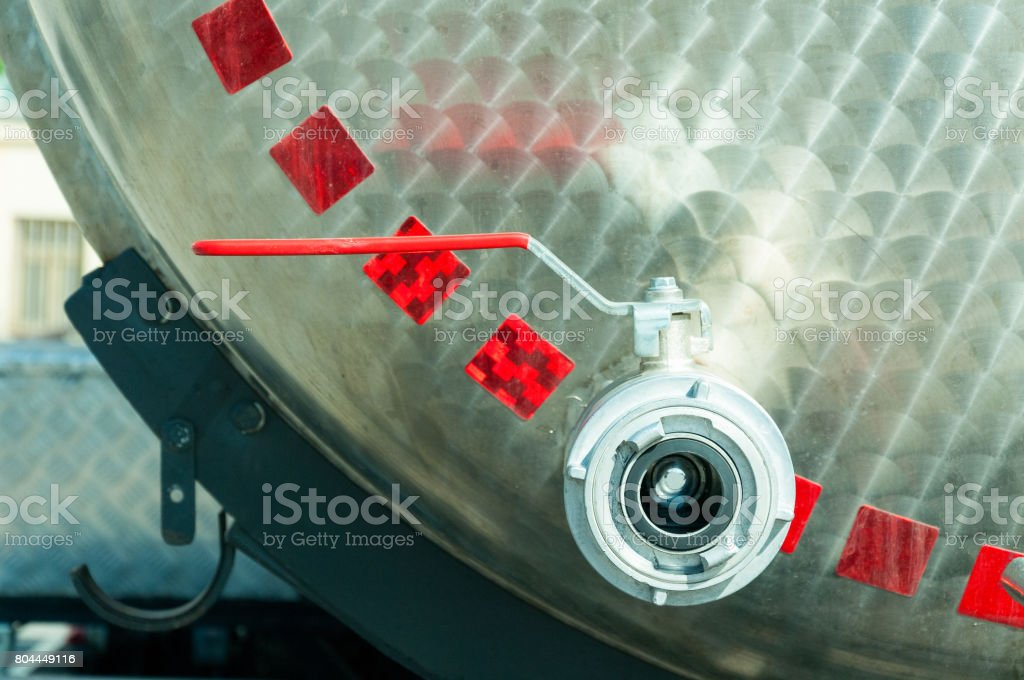 Cistern truck tank safety water valve. Close up. Selective focus. stock photo