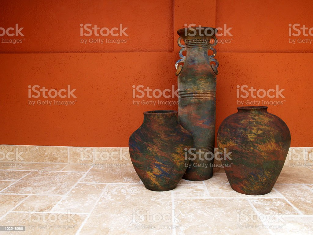 Cisterns against a red wall stock photo
