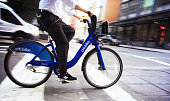 Citibike and Rider in Motion in Soho Manhattan