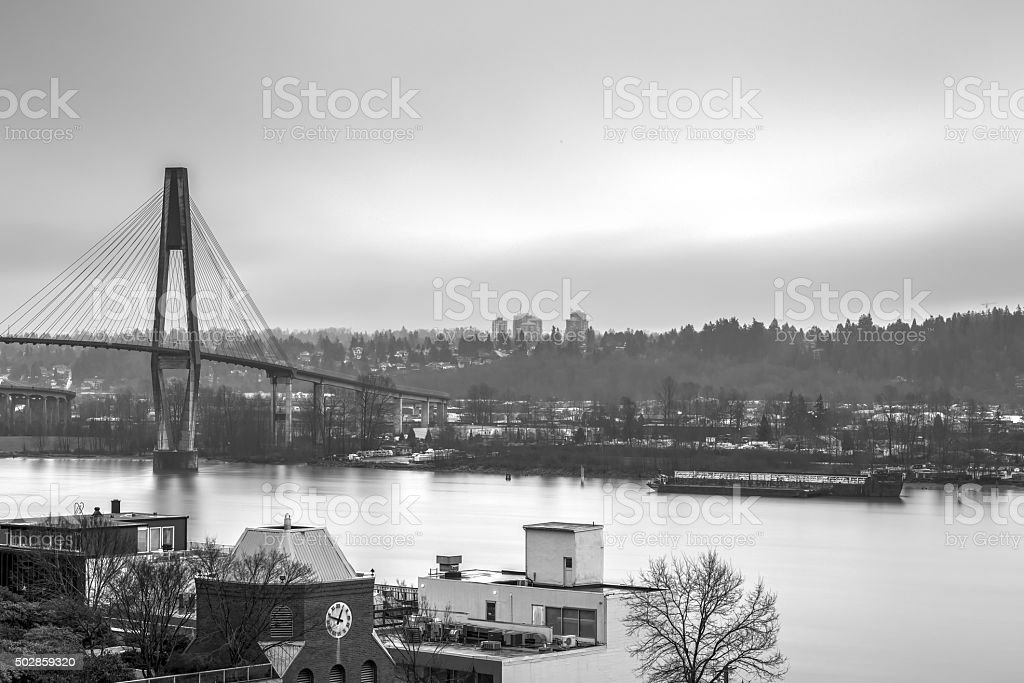 cities by the river in a rainy winter day stock photo