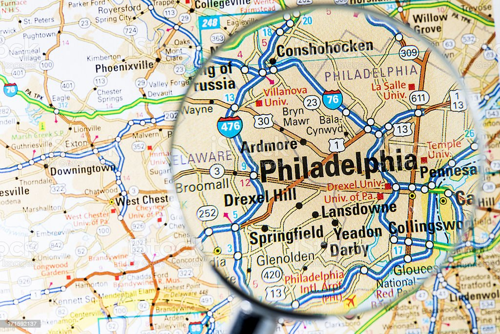 Cities under magnifying glass on map: Philadelphia stock photo