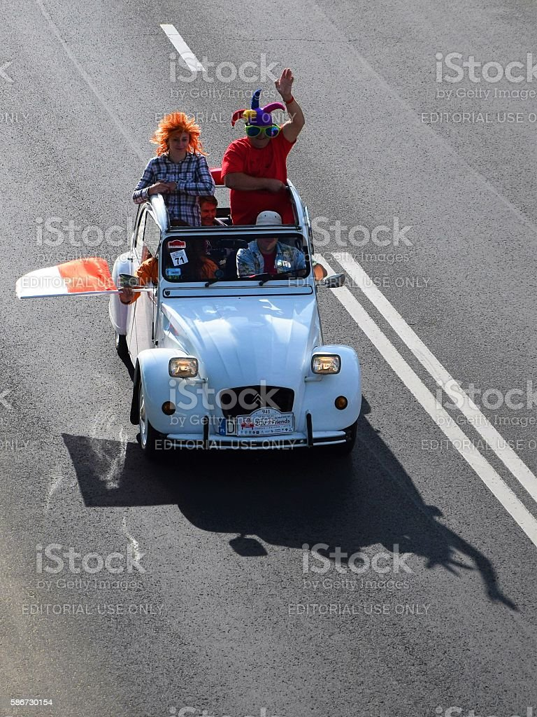 Citroen 2CV driving on the street during the parade stock photo