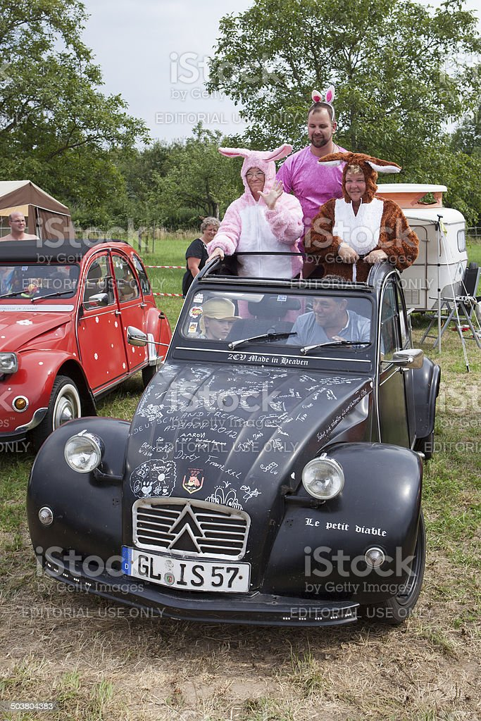 Citroen 2CV rally and costumed fans royalty-free stock photo