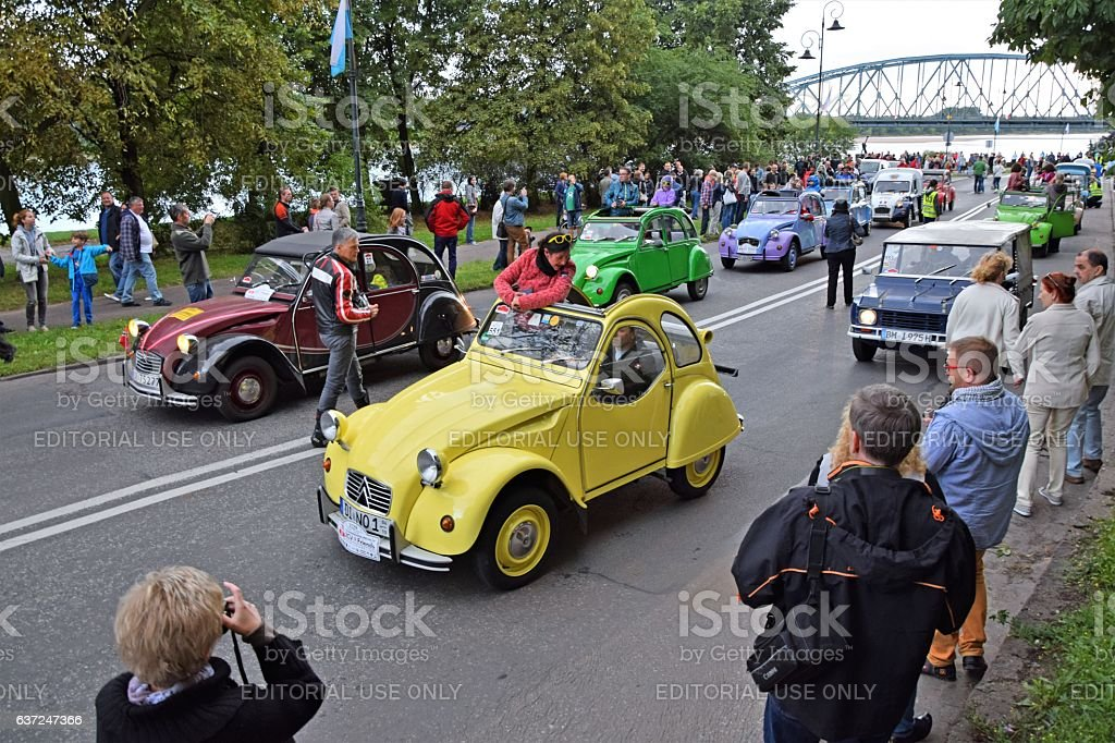 Citroen 2CV vehicles driving on the street during the parade stock photo