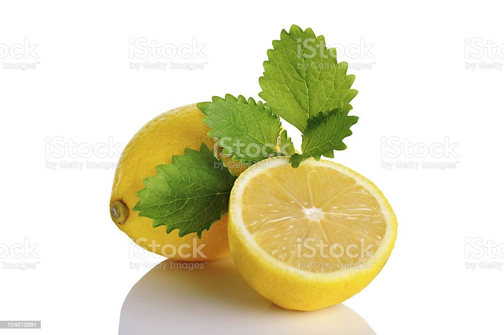 Citron Fruits with Lemon Balm Leafs stock photo