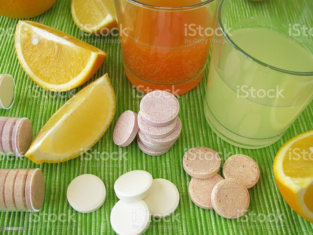 Citrus fruit and drinks and lemonade tablets stock photo