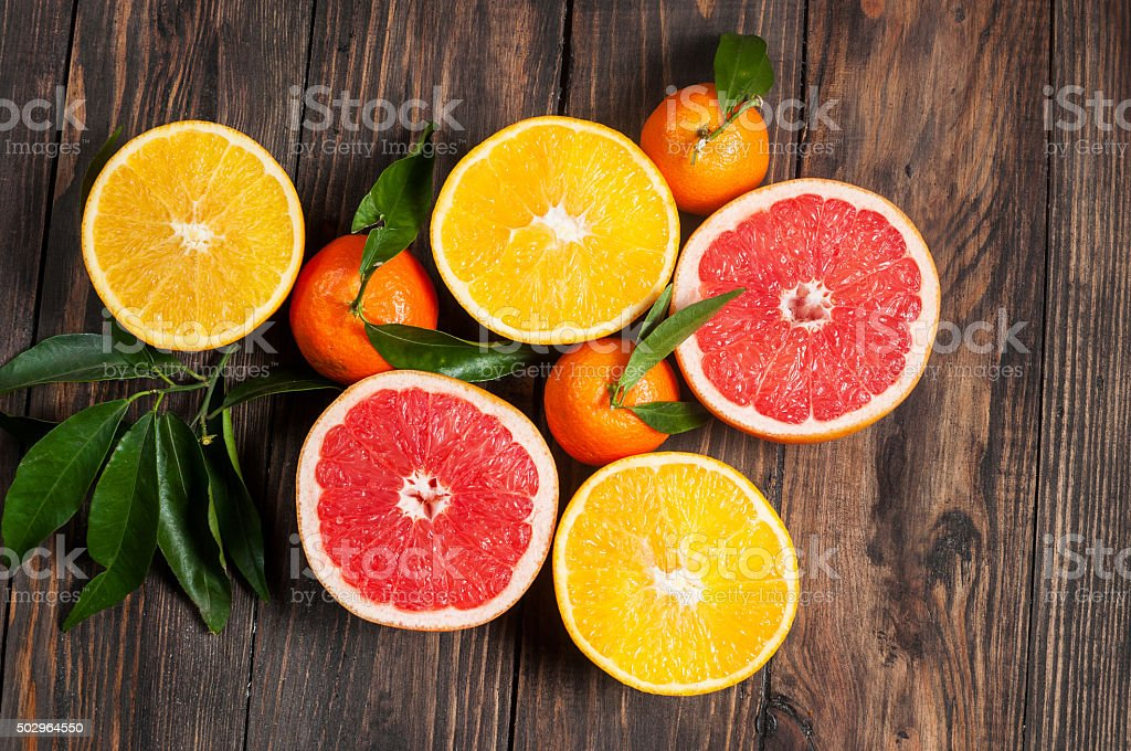 Citrus fruits. Over wooden table background stock photo