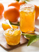 Citrus jam on wooden cutting board
