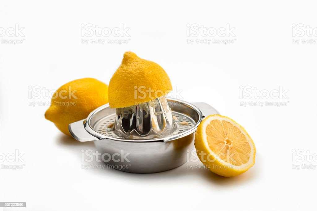 citrus juicer with one squeezed lemon on white stock photo