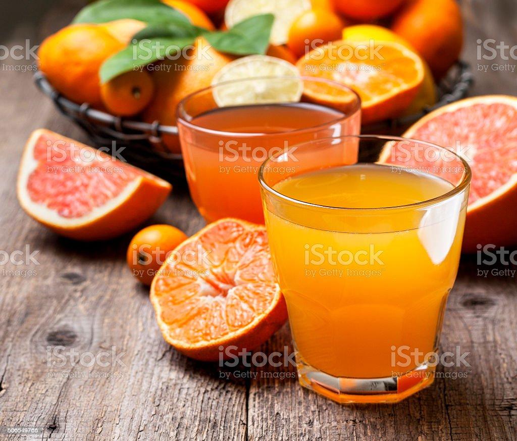 Citrus juices and fresh citrus fruit stock photo