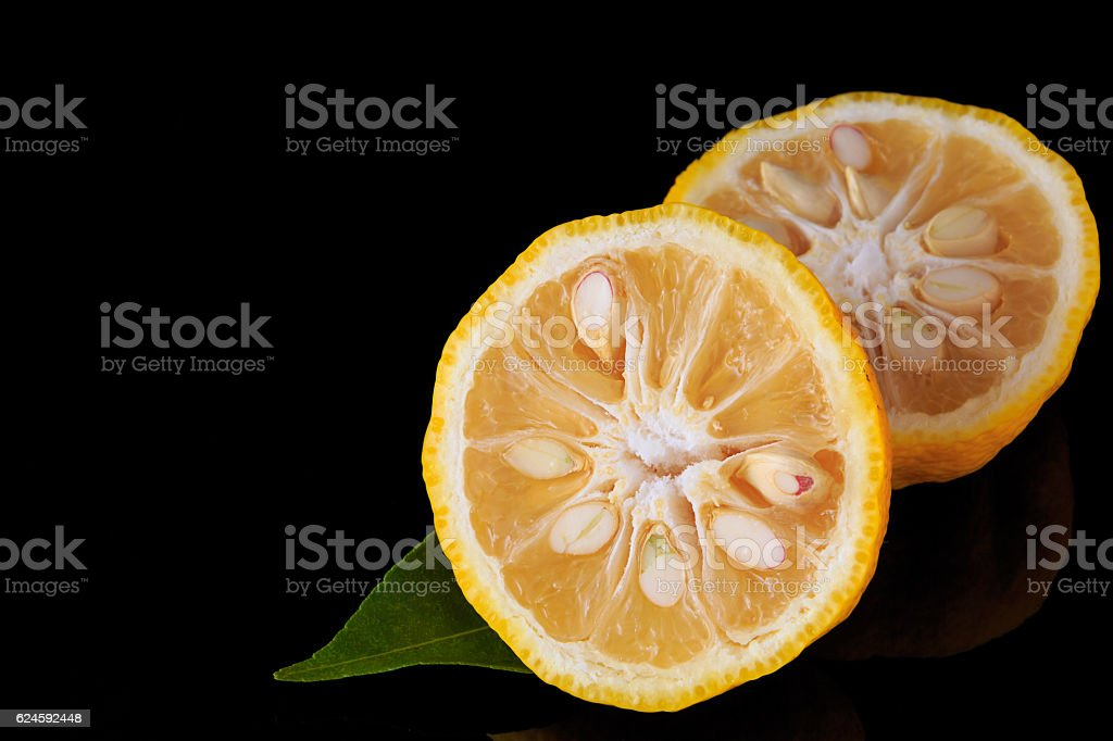 Citrus junos on black background stock photo