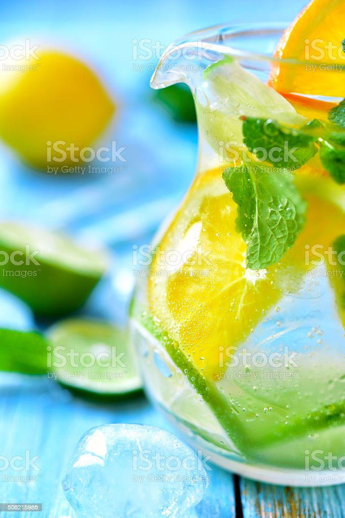 Citrus lemonade in a glass pitcher. stock photo