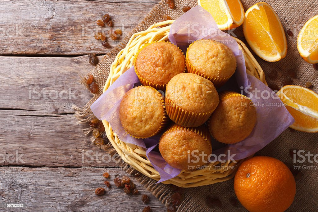 Citrus muffins and fresh oranges close-up. horizontal top view stock photo