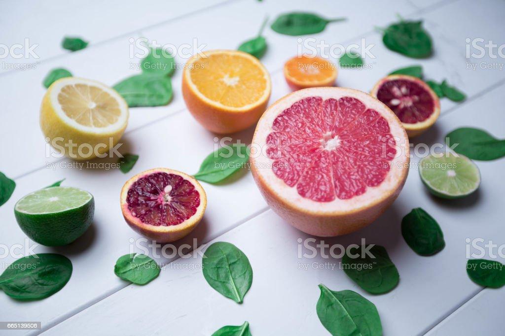 Citruses on white wooden background stock photo