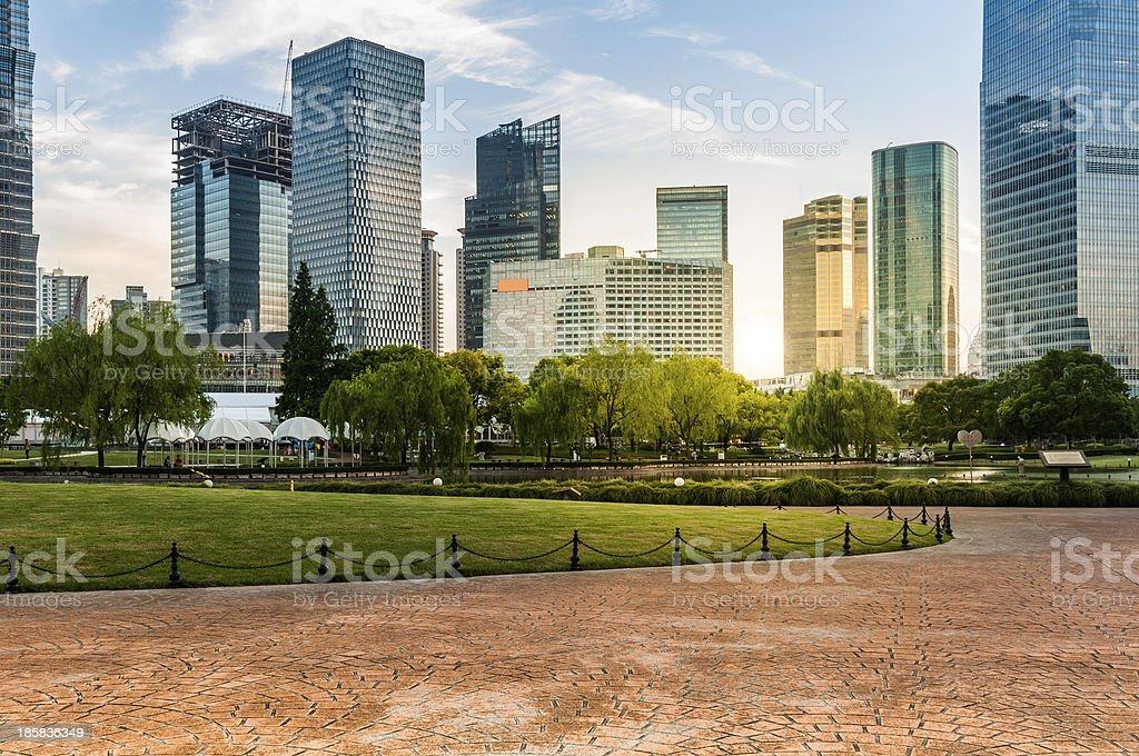 city and grass with blue sky stock photo