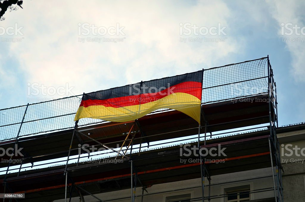 city and houses decorated with german flags stock photo