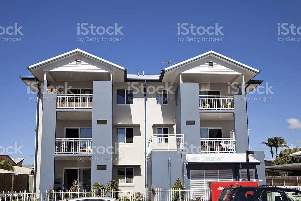 City Apartment Building with blue sky stock photo