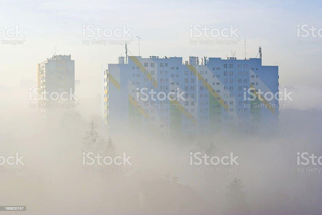 city at misty sunrise stock photo