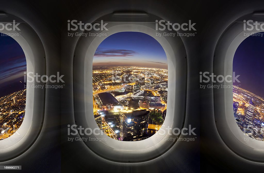 City at night through airplane window royalty-free stock photo