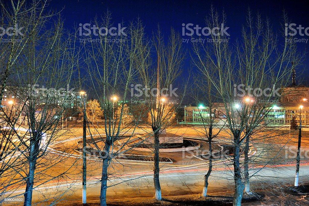 city at night with stars stock photo