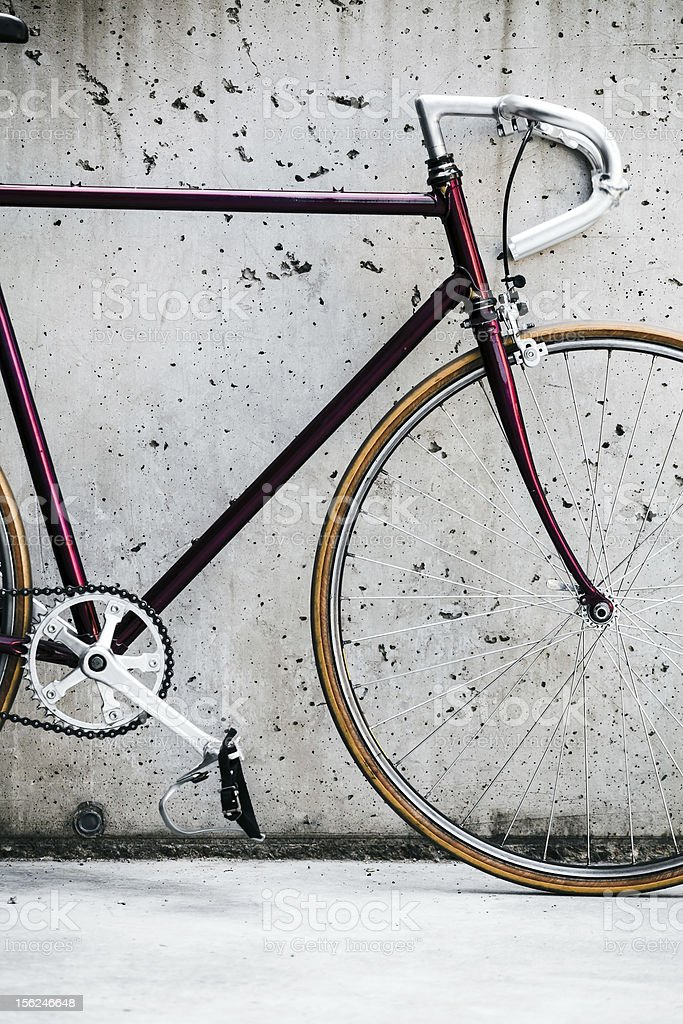 City bicycle and concrete wall, vintage style royalty-free stock photo