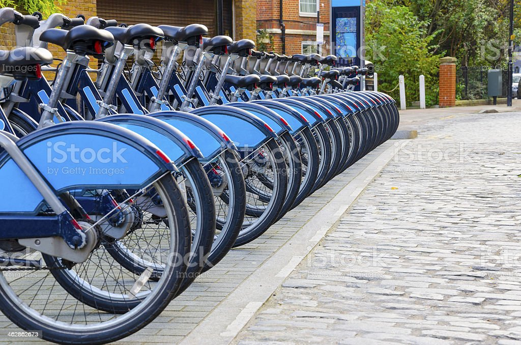 City bicycles aligned at docking station in London, England stock photo