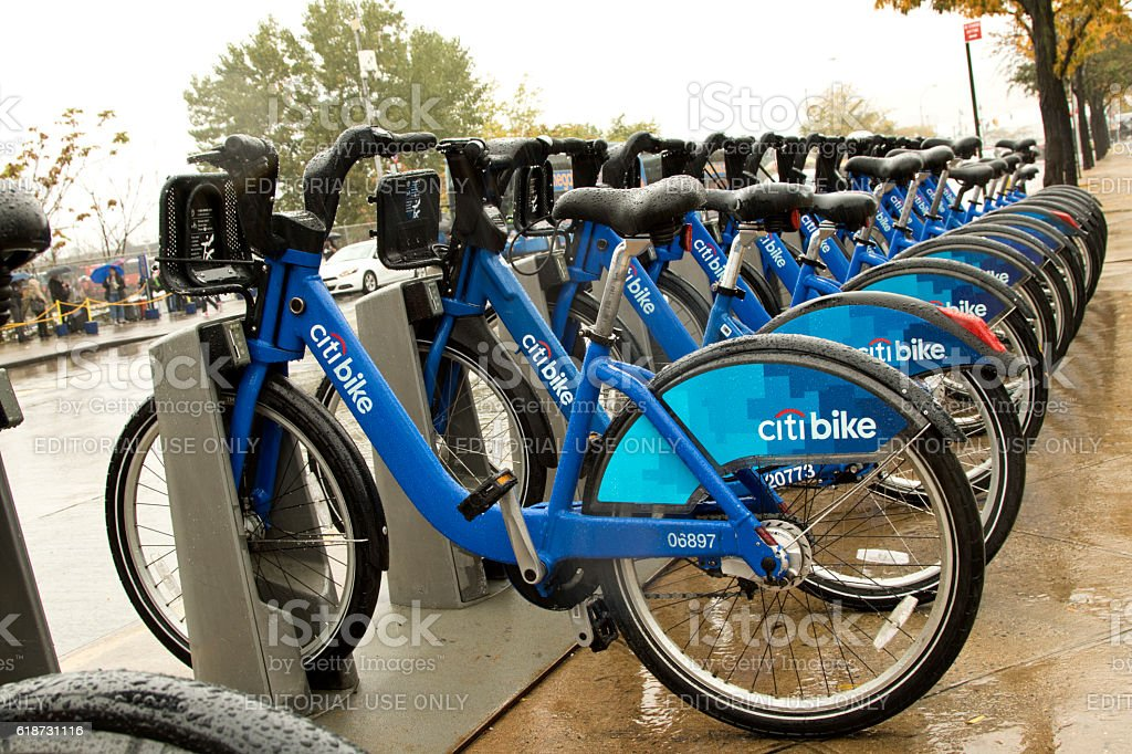NYC City Bike sharing system bicycles all wet stock photo
