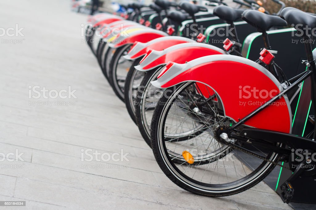 city bike stand with red bicycles stock photo