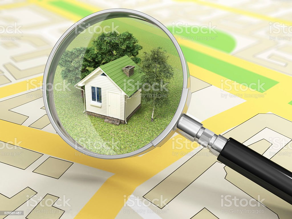 City building in tne magnifier. House search concept. stock photo
