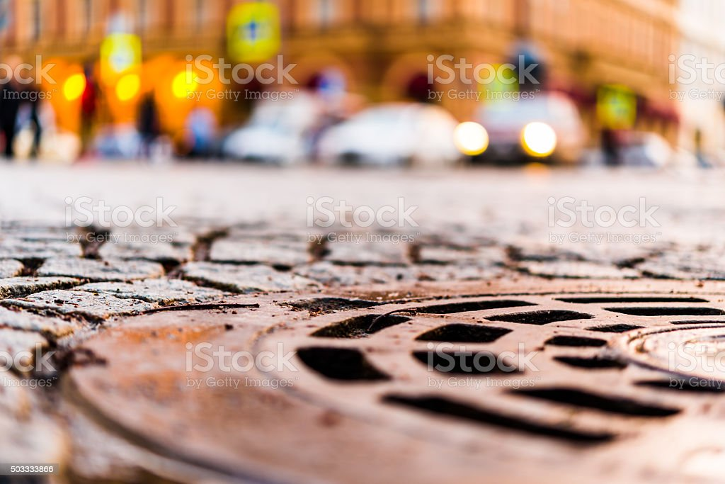 City central square paved with stone, car traveling stock photo