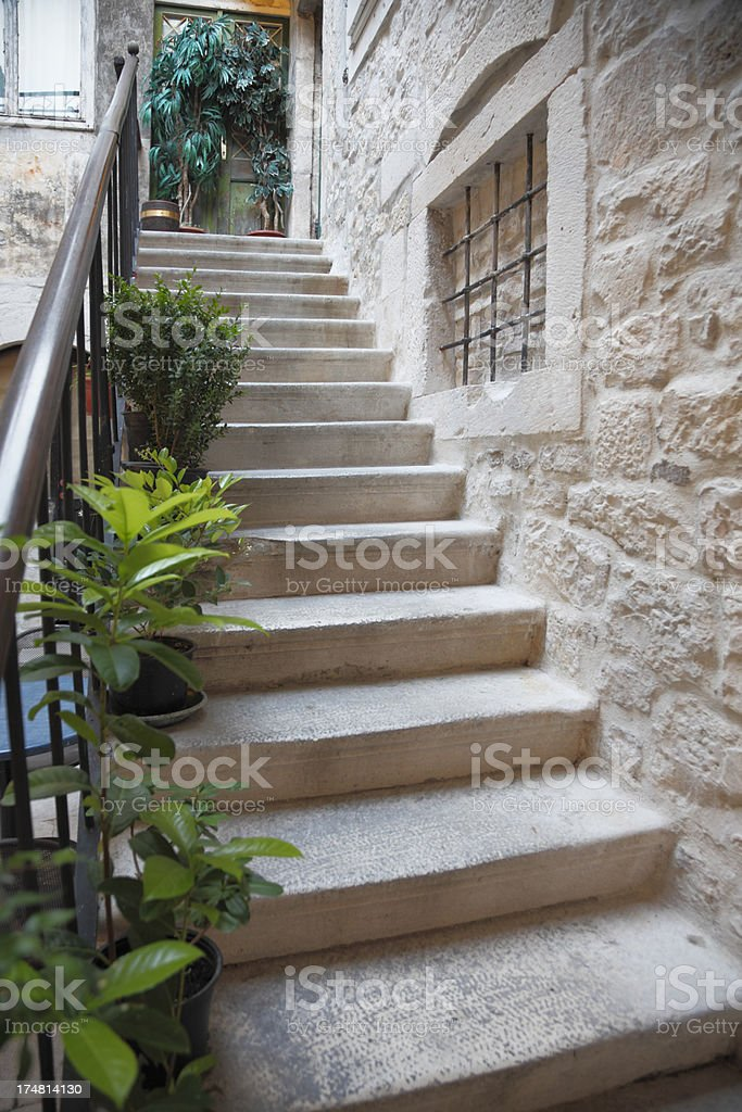 city cobblestone alley with stairs to house entrance Croatia royalty-free stock photo