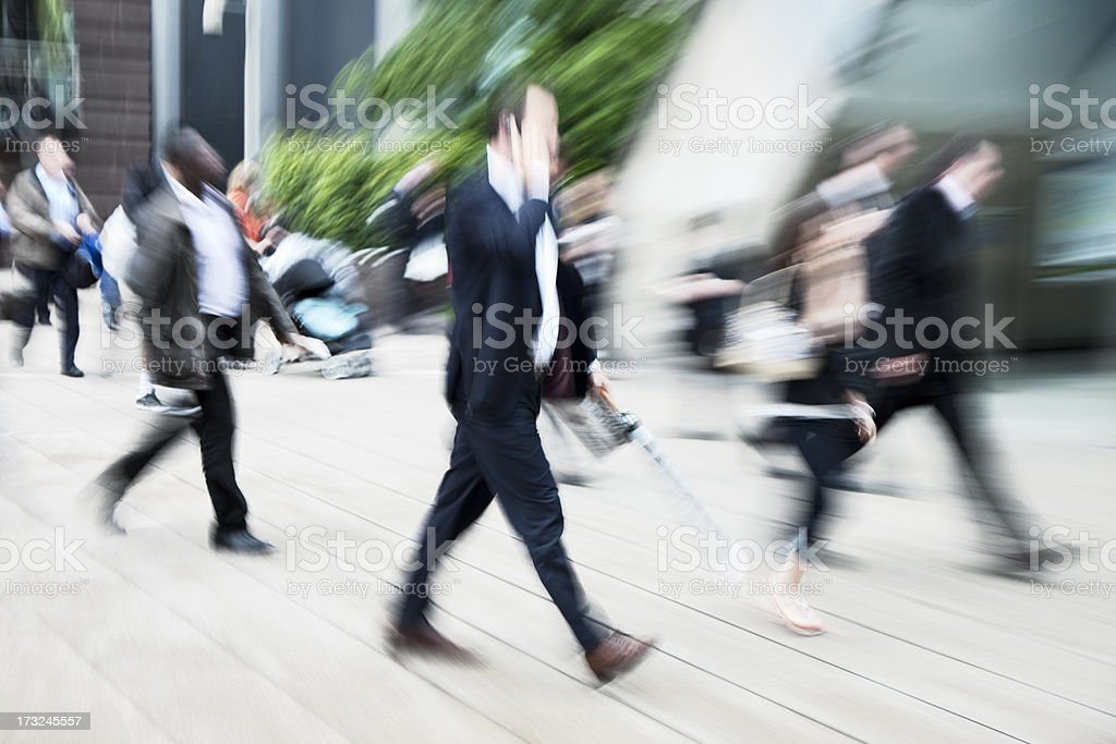 City Commuters, Blurred Motion, Canary Wharf Financial District, London, England royalty-free stock photo