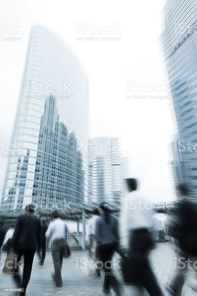 City Commuters Toward Office Buildings with Blur Motion stock photo
