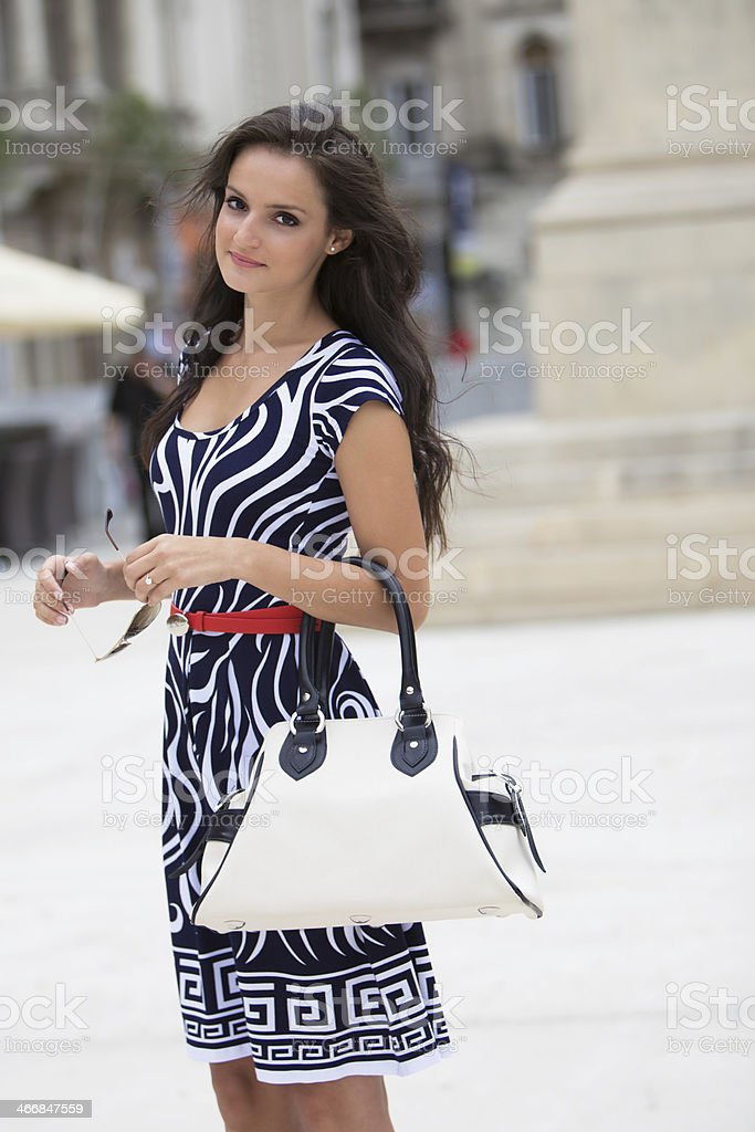 City fashion. A cute brunette royalty-free stock photo