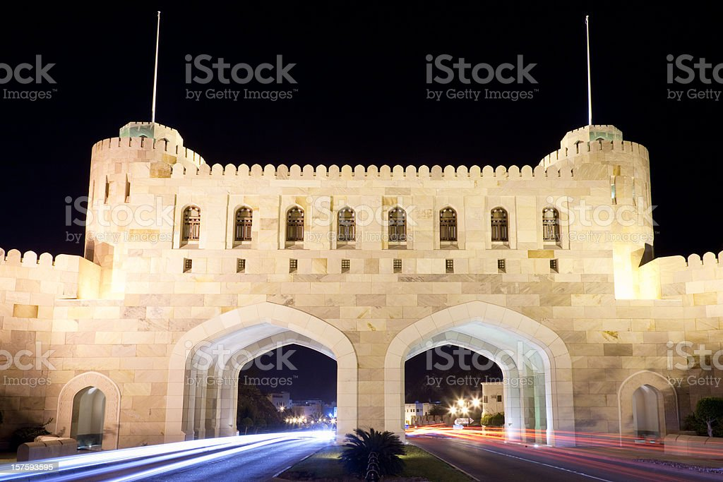 City Gate Masqat with Car Light Trails at Night Oman stock photo