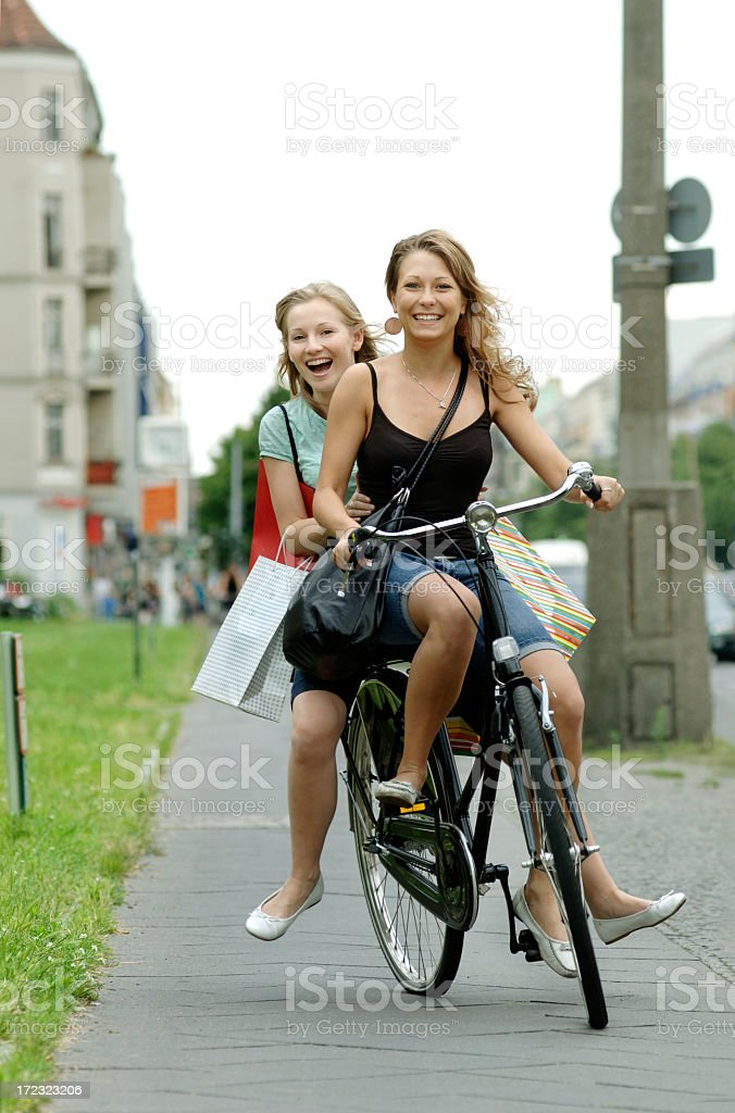 City Girls on a Bike royalty-free stock photo