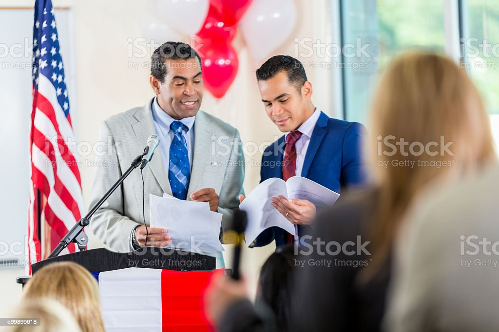 City government official discussing budget during town hall meeting stock photo