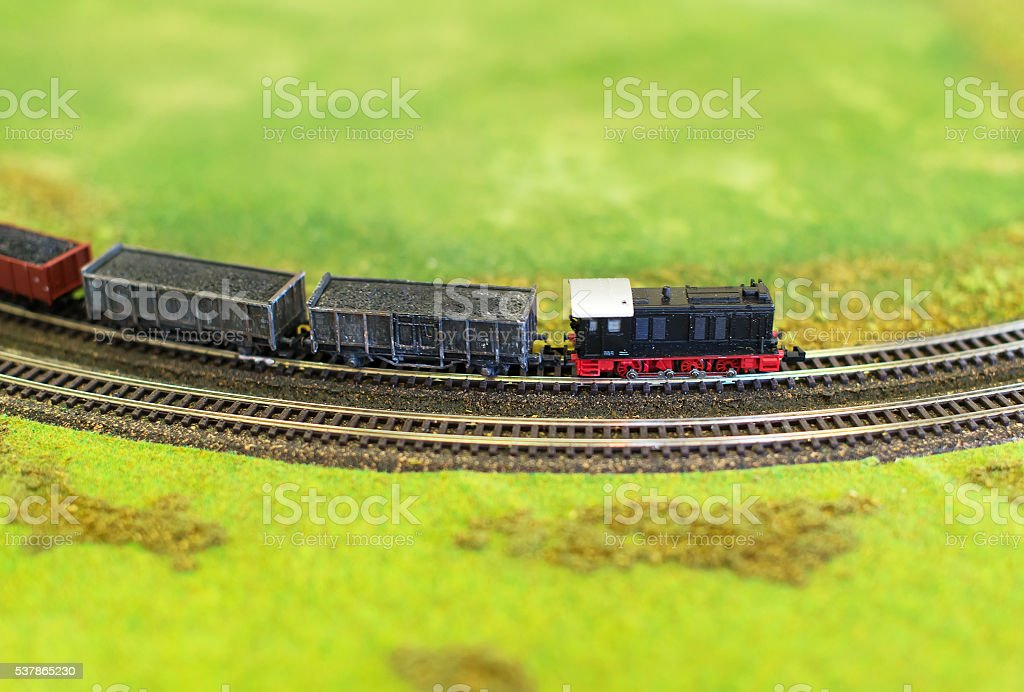 City in miniature. Miniature model of train with wagons. stock photo