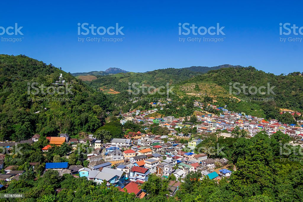 City in the forest mountain stock photo