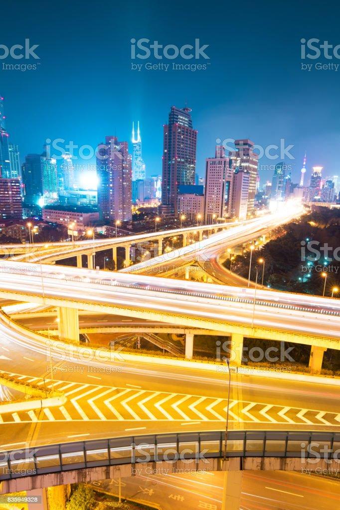 city interchange overpass at night in shanghai stock photo