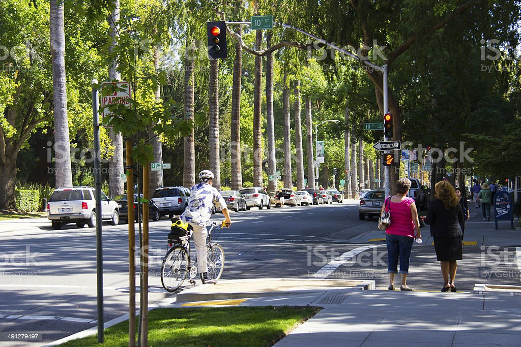 City life man on bike, women walking stock photo