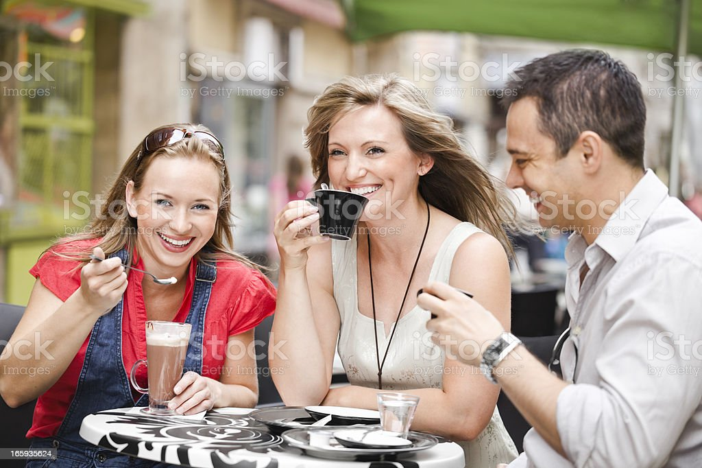 City life series: friends having a cup of coffee royalty-free stock photo