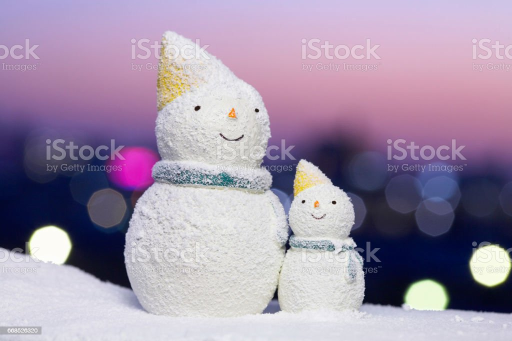 City lights with snowmen stock photo