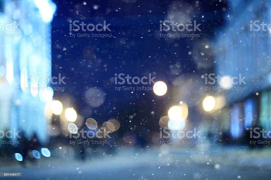 city ​​night winter snow blurred background stock photo
