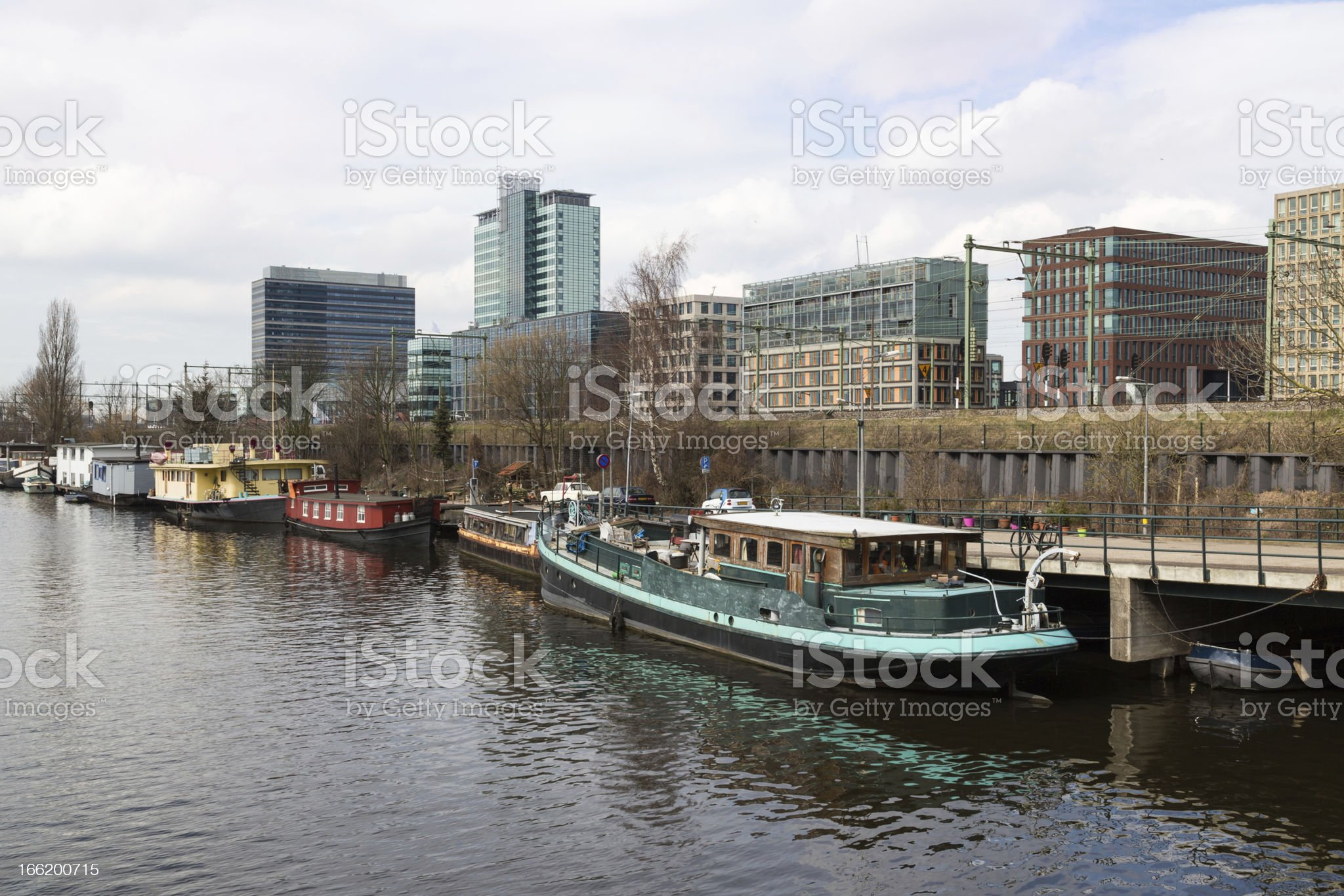 City of Amsterdam with office buildings and houseboats royalty-free stock photo
